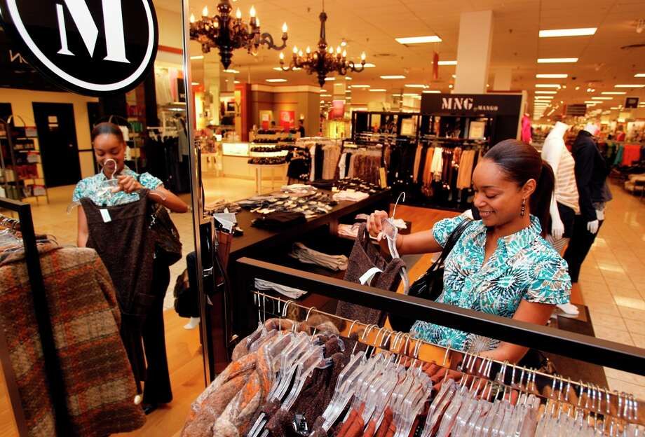 Erica Gorrell of Houston shops at the new MNG by Mango section inside a Houston JC Penney. Melissa Phillip/Houston Chronicle
