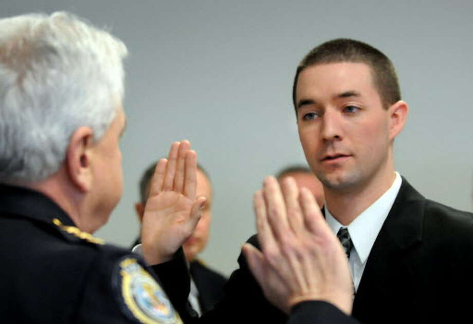 Kevin Weatherby, right, is shown being sworn in as a Troy police officer on Tuesday, Jan. 12, 2010. (Cindy Schultz / Times Union)