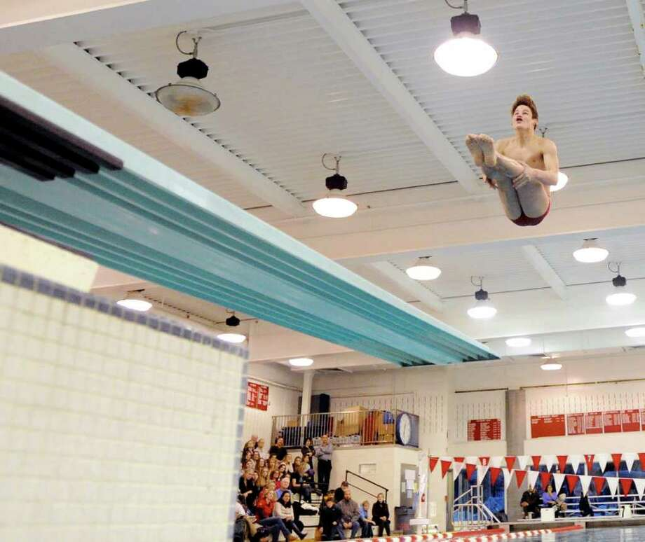Greenwich High School diver Connor Brisson in action during boys swim meet between Greenwich High School and Westhill-Stamford High Schools at the Greenwich High School pool, Thursday afternoon,  Jan. 13, 2011. Photo: Bob Luckey / Greenwich Time