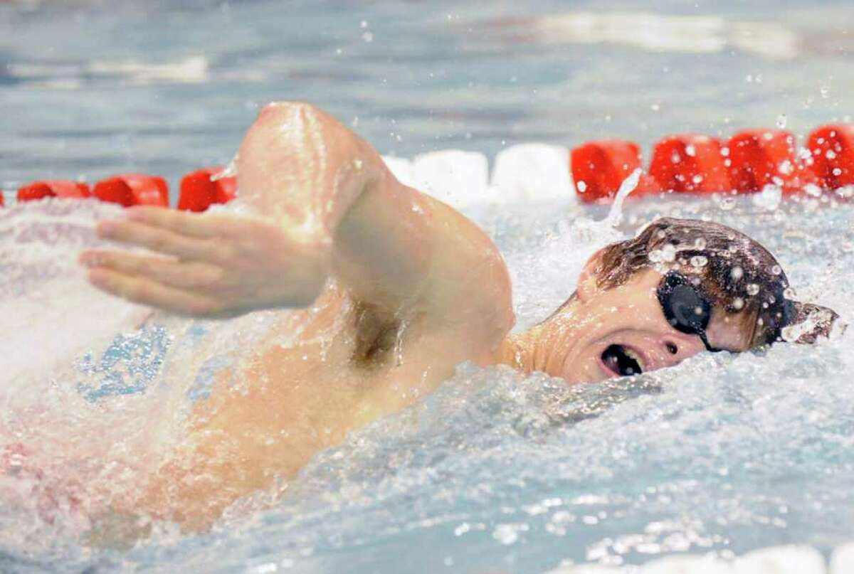 Andrew Dillinger of Greenwich High School competes in the 200 yard freestyle event during the boys swim meet between Greenwich High School and Westhill-Stamford High Schools at the Greenwich High School pool, Thursday afternoon, Jan. 13, 2011.