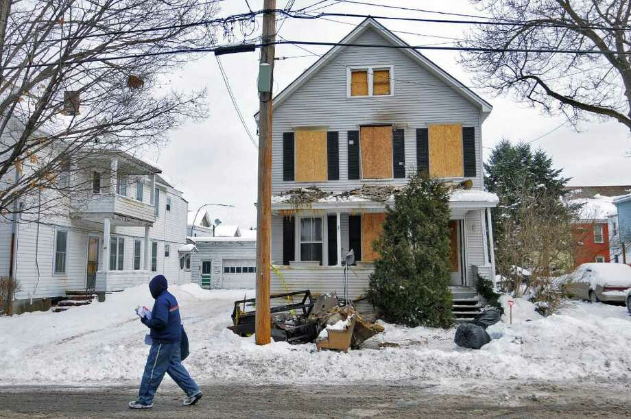 View of the fire damaged 132 North Third Avenue in Mechanicville,  Thursday morning. The fire happened on Wednesday night, and left five people homeless. No one was hurt, but a cat died.( Philip Kamrass / Times Union ) Photo: Philip Kamrass