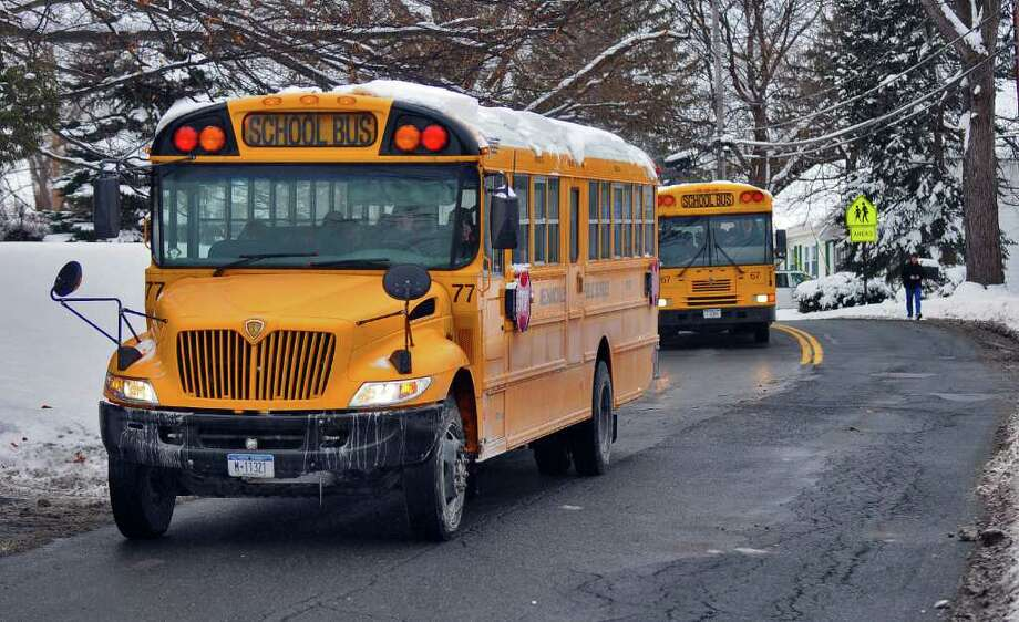 Mechanicville school buses drive on South Street after school on Thursday afternoon January 13, 2011.( Philip Kamrass / Times Union ) Photo: Philip Kamrass