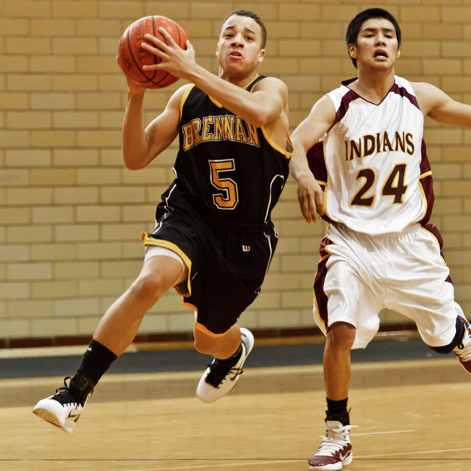 Brennan point guard John Azzinaro (left) has been a spark plug behind the first-year Bears' 17-8 season. Azzinaro is the lone Brennan player with varsity experience last year. Photo: Marvin Pfeiffer/Prime Time / Prime Time Newspapers 2010