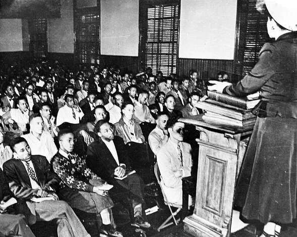 Martin Luther King, third from left, listens to a speaker during an assembly at Morehouse College, in Atlanta, GA, in 1948. King subsequently graduated from the college with a Bachelor of Arts degree in Sociology. (AP Photo) / Beaumont
