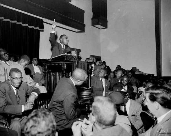"The Rev. Martin Luther King, Jr. is shown speaking to an overflow crowd at a mass meeting at the Holt Street Baptist Church.  King, leader of the mass bus boycott, was found guilty March 22, 1956 of conspiracy in the Montgomery bus boycott. He was fined $500.  King said the boycott of city buses will continue ""no matter how many times they convict me.""   (AP Photo/Gene Herrick) Photo: GENE HERRICK, STF / Beaumont"