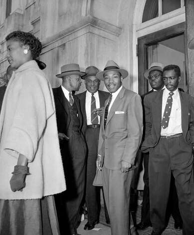 The Rev. Dr. Martin Luther King, Jr., center, appears at noon recess on the first day of trials in the Montgomery, Ala. racial bus boycott, March 19, 1956.  (AP Photo/Gene Herrick) Photo: GENE HERRICK, STF / Beaumont