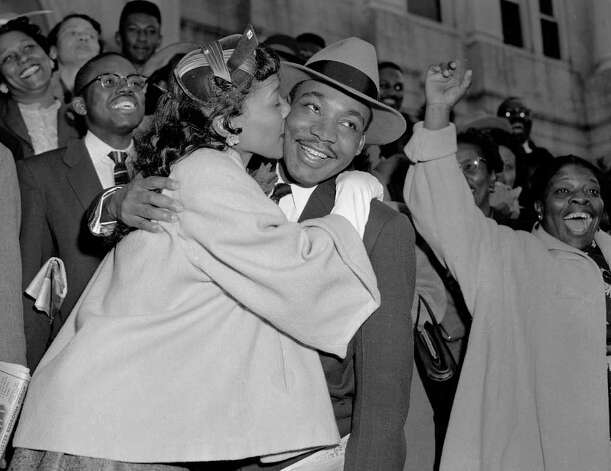 The Rev. Martin Luther King Jr. is welcomed with a kiss by his wife Coretta after leaving court in Montgomery, Ala., March 22, 1956. King was found guilty of conspiracy to boycott city buses in a campaign to desegregate the bus system, but a judge suspended his $500 fine pending appeal. (AP Photo/Gene Herrick) Photo: Gene Herrick, STF / Beaumont