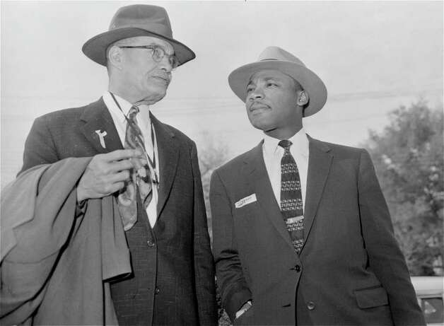 The Rev. Martin Luther King, Jr., left, is pictured talking with C. Ewbank Tucker, Louisville, Kentucky, one of his eight attorneys and also a preacher, as both  arrived at the Montgomery, Ala. county courthouse March 22, 1956, for the fourth day of King's trial in the city's racial bus boycott.  Defense attorneys said they might put King on the stand.  Ninety blacks are charged with violation of the state boycott law.  (AP Photo/Gene Herrick) Photo: GENE HERRICK, STF / Beaumont