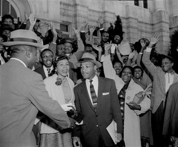 The Rev. Ralph Abernathy, left, shakes hands with the Rev. Martin Luther King, Jr., in Montgomery, Ala., March 22, 1956, as a big crowd of supporters cheer for King who had just been found guilty of leading the Montgomery bus boycott.  Circuit Judge Eugene Carter suspended the fine of $500 pending an appeal.  King's wife Coretta stands next to him.  (AP Photo/Gene Herrick) Photo: GENE HERRICK, STF / Beaumont