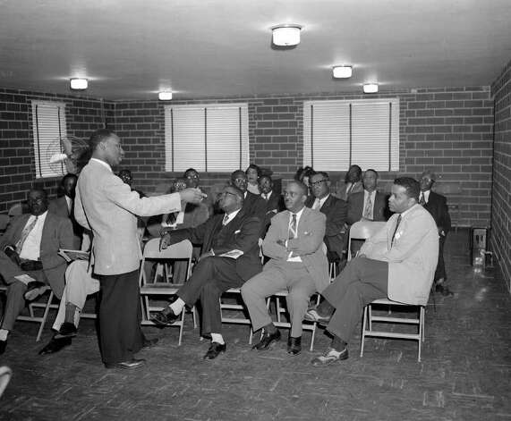 The Rev. Martin Luther King, Jr., standing, holds a meeting with the Executive Board of the Montgomery Improvement Association, after orders were issured to end segregation by the Montgomery City Lines following a successful five month boycott, April 24, 1956.   (AP Photo/Horace Cort) Photo: HORACE CORT, STF / Beaumont