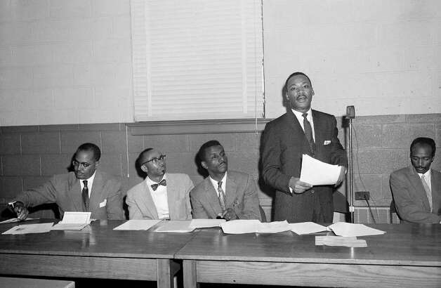 From left to right:  the Revs. T.J. Jemison of Baton Rouge, La.; C.K. Steele of Tallahassee, Fla.; F.L. Shuttlesworth of Birmingham, Ala.;  Martin Luther King, Jr., are seen leading a conference of southern black leaders studying bus integration, Jan. 11, 1957, in Atlanta.  The group telegraphed Pres. Eisenhower to come south to aid their