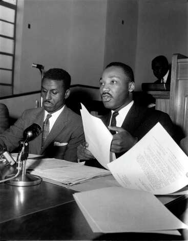 Rev. Martin Luther King Jr., Montgomery, Ala., reads the telegram sent to U.S. President Dwight D. Eisenhower by the Southern Negro Leaders Conference at a meeting in New Orleans, La., Feb. 14, 1957.  The telegram says that a ma