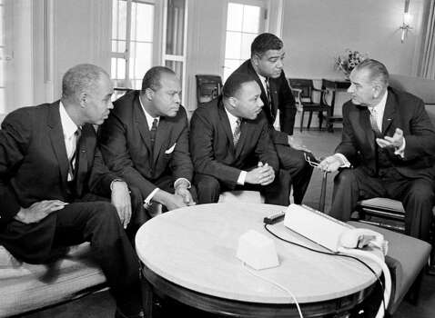 U.S. President Lyndon B. Johnson, right, talks with civil rights leaders in his White House office in Washington, D.C., Jan. 18, 1964.  The black leaders, from left, are, Roy Wilkins, executive secretary of the National Association for the Advancement of Colored People (NAACP); James Farmer, national director of the Committee on Racial Equality; Dr. Martin Luther King Jr., head of the Southern Christian Leadership Conference; and Whitney Young, executive director of the Urban League.  (AP Photo) / Beaumont