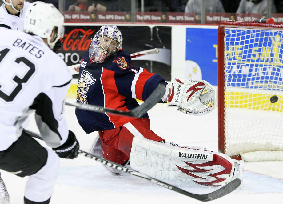 The Rampage's Jamie Bates (left) scores on Grand Rapids Griffins goaltender Jordan Pearce on Thursday. Photo: Darren Abate/Special To The Express-News / Darren Abate/pressphotointl.com