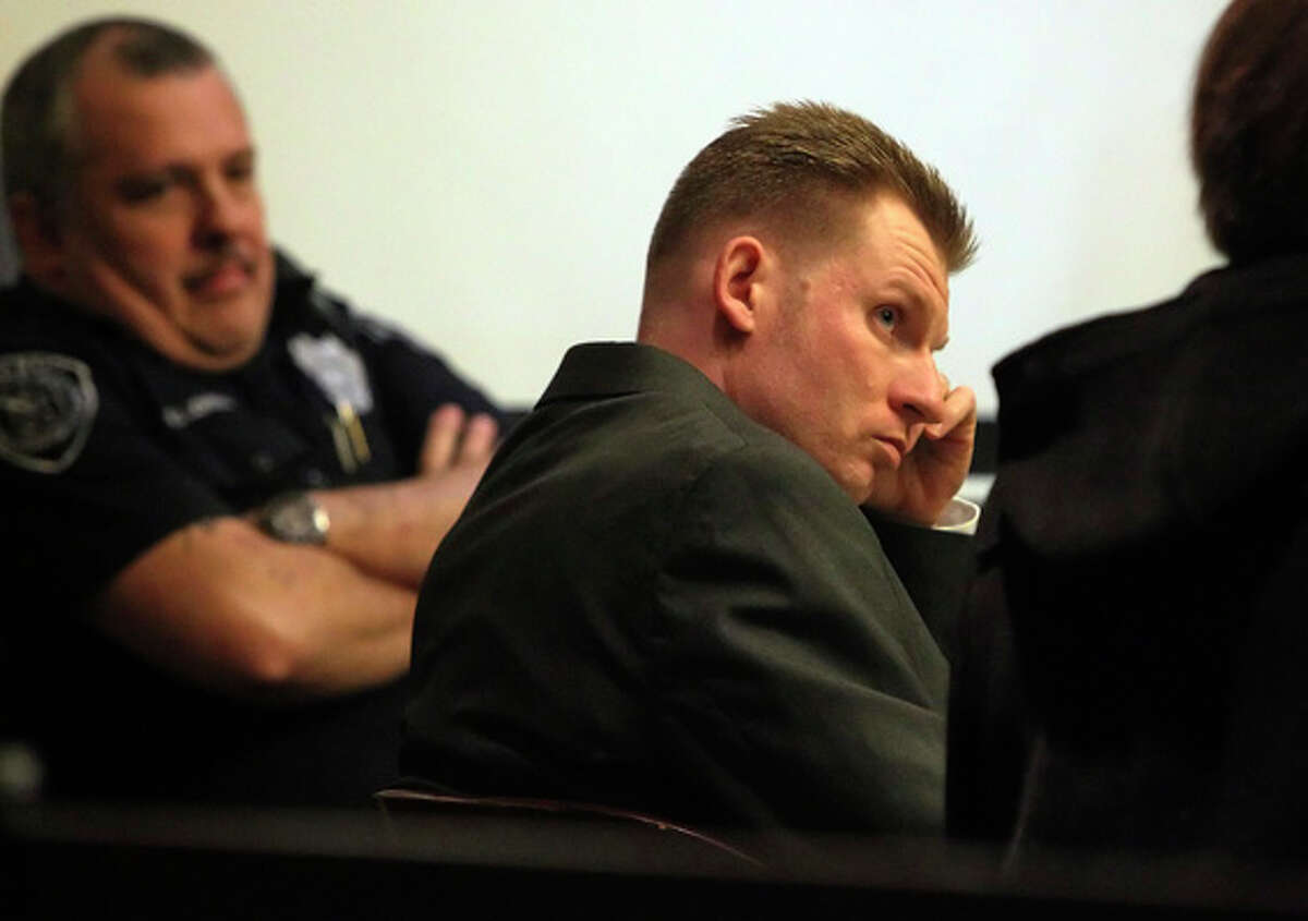 Thomas Ahrens (center) appears in court for his murder trial on Jan. 13, 2011. Ahrens is accused of killing Christopher Duncan in February 2008.
