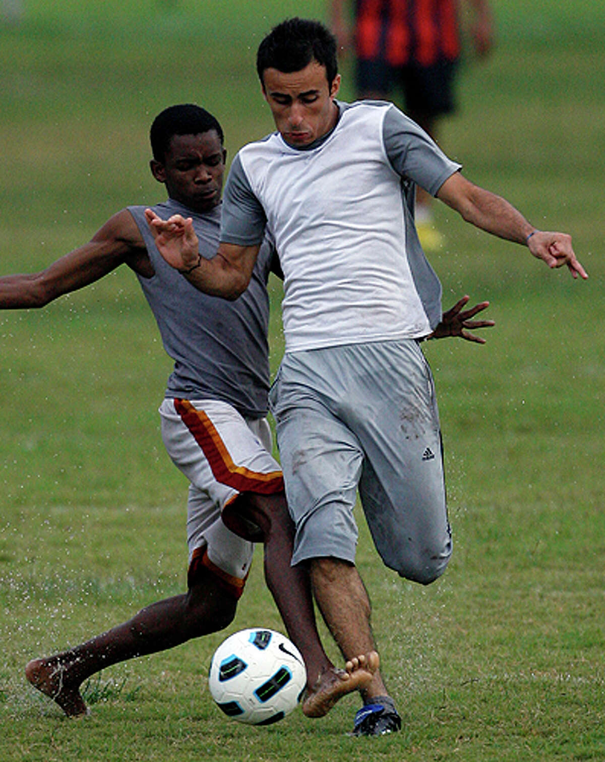 Mohammed 'Tito' Ibrahim battles for a ball during a game against Team Somali at St. Matthew's Recreational field. A dozen young Iraqi men formed a soccer team to stay close to their heritage and support each other as they tackle new lives in a new land.