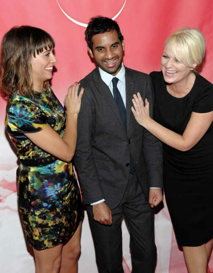 Actress Rashida Jones, left, actor Aziz Ansari, center, and actress Amy Poehler arrive at the NBC Universal 2011 Winter Press Tour party in Pasadena, Calif. on Thursday, Jan. 13, 2011. Photo: AP