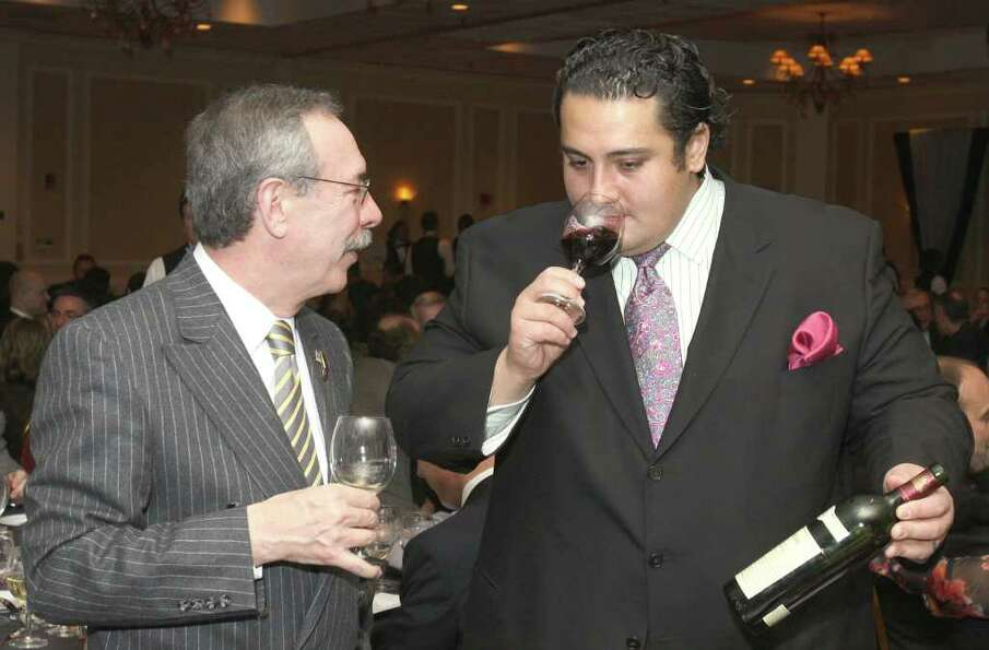 William Harris, left, talks wine with Dominick Purnomo, sommelier and co-owner of Yono's and DP: An