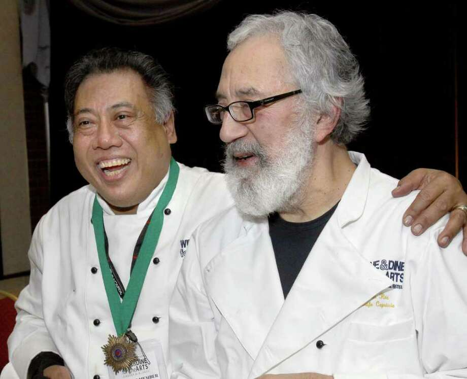 Chefs Yono Purnomo, left, and Jim Rua talk with diners at the event. (Joe Putrock / Special to the Times Union) Photo: Joe Putrock / Joe Putrock