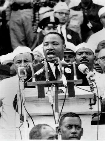 "Martin Luther King, Jr. delivers his famous speech on the steps of the Lincoln Memorial in Washington on August 28, 1963.  King told the crowd of 200,000 people, ""I have a dream that this nation will rise up and live out the true meaning of its creed, 'We hold these truths to be self evident: that all men are created equal'."" (Associated Press) Photo: ASSOCIATED PRESS / EXPRESS-NEWS FILE PHOTO"
