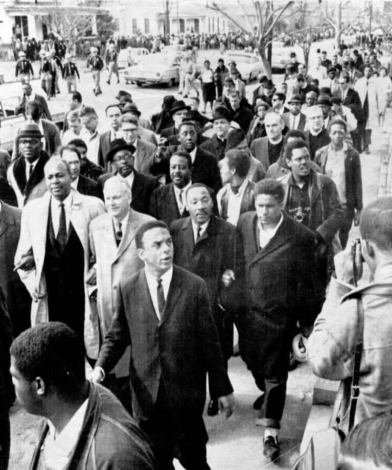 TODAY IN HISTORY/WED 03 21 01/MLK SELMA MARCH - Martin Luther King is shown leading a civil rights march in Selma, Alabama, March 21, 1965.  More than 3,000 civil rights demonstrators led by the Rev. Martin Luther King Jr. began their march from Selma to Montgomery, Alabama.  In front of King is Rev. Andrew Young, who later became United Nations ambassador.  Marching with King from left:  James Farmer, Bishop Lord, King and James Forman.  Behind King is Rev. Ralph Abernathy.  CREDIT: ASSOCIATED PRESS  