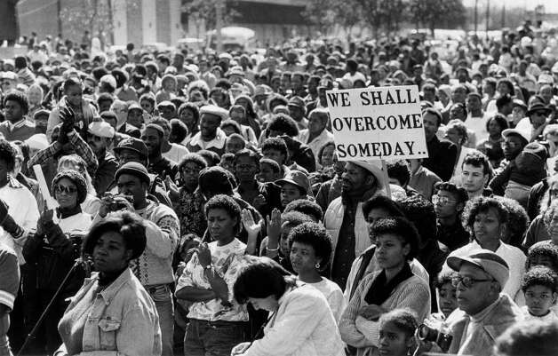 Then&Now_MLK0120 -- FILE PHOTO -- San Antonio's annual march honoring the late Martin Luther King Jr. began 15 years ago, five years before Texas designated a day specifically to honor the inspirational civil rights leader.
