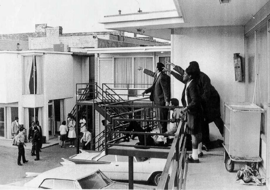 Aides to Martin Luther King point to the area from where they heard the shot that killed King, lying on balcony, in Memphis, Tenn.  April 4, 1968.  This photo was released by Life magazine, which obtained it from photographer Joseph Louw, a TV producer who was in a motel room two doors from King's when he heard the shot.  Photo: TIME INC. / ASSOCIATED PRESS/ E/N FILE PHOTO