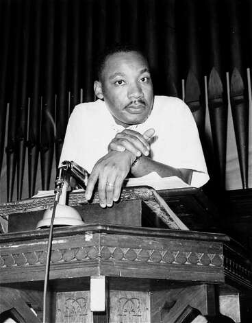 **FILE - FOR USE AS DESIRED **  Rev. Martin Luther King, Jr., is pictured at an integration rally in Montgomery, Ala. in this May 21, 1961 file photo. Photo: HORACE CORT, AP / AP