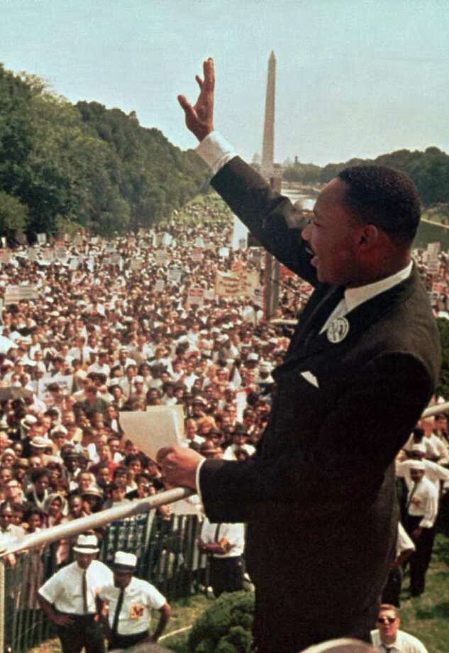 """The Rev. Martin Luther King Jr. acknowledges the crowd at the Lincoln Memorial for his """"I Have a Dream"""" speech during the March on Washington, D.C.,  oin this Aug. 28, 1963, file photo.  The march was organized  to support proposed civil rights legislation and end segregation.  King founded the Southern Christian Leadership Conference in 1957, advocating nonviolent action against America's racial inequality.  He was awarded the Nobel Peace Prize in 1964, and was assassinated in Memphis, Tenn., in April 1968.   (AP Photo) Photo: AP / AP"""