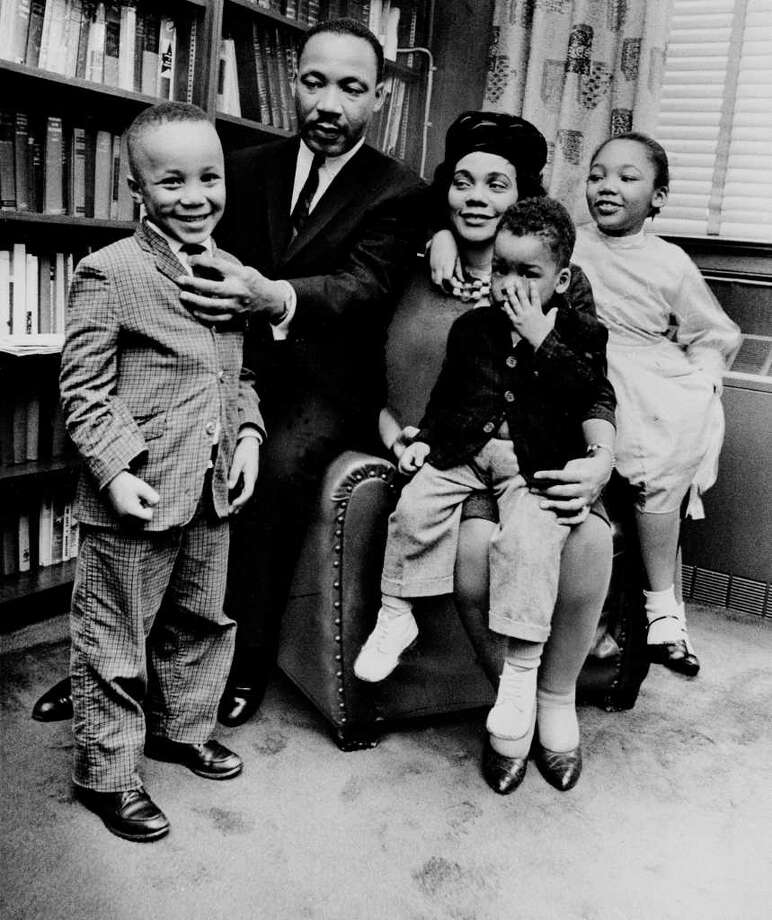 ** FILE ** Dr. Martin Luther King Jr. and his wife, Coretta Scott King, sit with three of their four children in their Atlanta, Ga, home, in this  March 17, 1963 file photo. From left are: Martin Luther King III, 5, Dexter Scott, 2, and Yolanda Denise, 7. Coretta Scott King, who turned a life shattered by her husband's assassination into one devoted to enshrining his legacy of human rights and equality, has died, former mayor Andrew Young told NBC Tuesday morning, Jan. 31, 2006. She was 78. (AP Photo) Photo: AP / AP