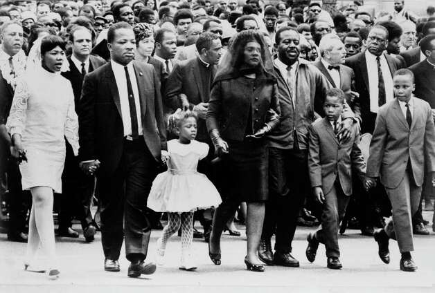** FILE ** The family of Dr. Martin Luther King, Jr. walk in the funeral procession of the slain civil rights leader, in Atlanta, in this April 9, 1968 file photo.  From left: daughter Yolanda, 12; King's brother A.D. King; daughter Bernice, 5; widow Coretta Scott King; Rev. Ralph Abernathy; sons Dexter, 7, and Martin Luther King III, 10.  Coretta Scott King, who turned a life shattered by her husband's assassination into one devoted to enshrining his legacy of human rights and equality, has died, former mayor Andrew Young told NBC Tuesday morning, Jan. 21, 2006. She was 78. Photo: AP / NEW YORK TIMES