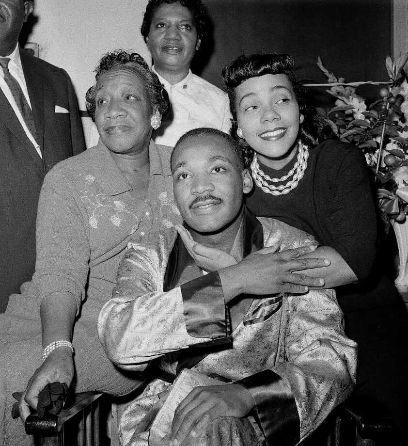 ** FILE ** Dr. Martin Luther King, Jr., is embraced by his wife Coretta Scott King during a news conference at Harlem Hospital in New York, in this Sept. 30, 1958 file photo, where he was recovering from a stab wound following an attack by a woman.  At left is his mother, Alberta Williams King. Scott King, who turned a life shattered by her husband's assassination into one devoted to enshrining his legacy of human rights and equality, has died, former mayor Andrew Young told NBC Tuesday, morning, Jan. 31, 2006. She was 78. Photo: TONY CAMERANO, AP / AP