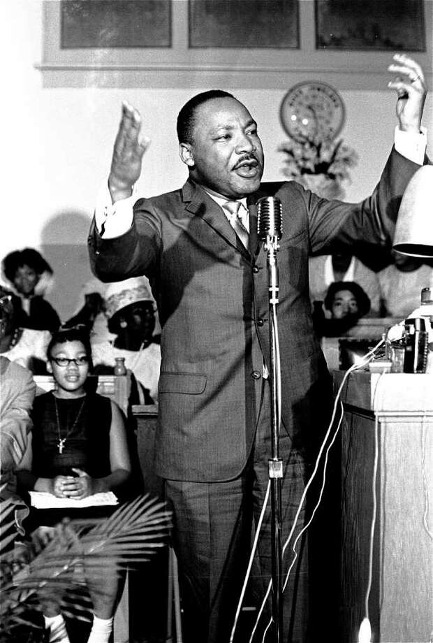 Yolanda Denise King, daughter of Civil Rights leader Martin Luther King, watches from the podium at left, as her father gestures during a speech at a political rally in Montgomery, Ala., April 29, 1966. King, daughter and eldest child of civil rights leader the Rev. Martin Luther King Jr., has died, said Steve Klein, a spokesman for the King Center. King died late Tuesday May 15, 2007 in Santa Monica, Calif., at age 51. Photo: JRT, AP / AP