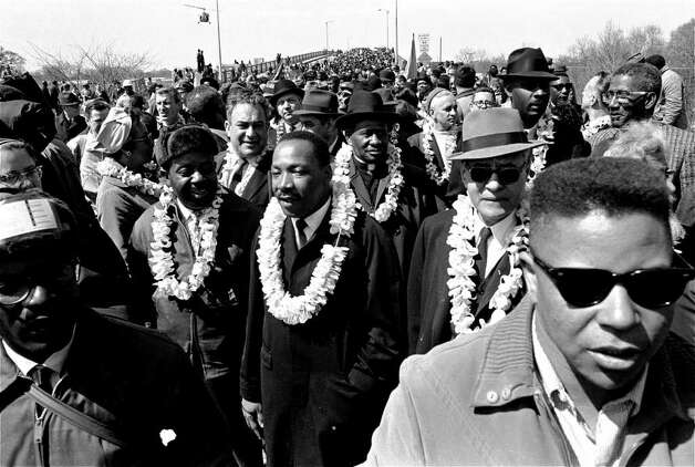 Martin Luther King, Jr. and his civil rights marchers head for Montgomery, the state's capitol, in this March 21, 1965 file photo. (AP Photo, File) Photo: Express-news, AP / AP