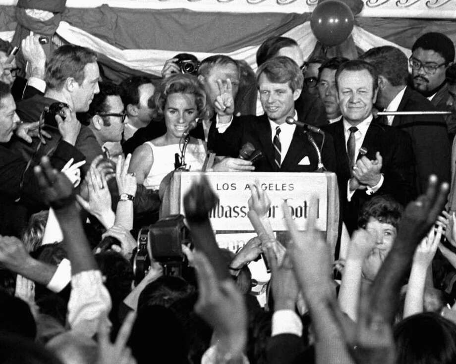 ** FILE ** In this June 5, 2968 file photo, Presidential candidate Sen. Robert F. Kennedy  speaks to campaign workers in Los Angeles minutes before he was shot June 5, 1968. At his side are his wife, Ethel, and his California campaign manager, Jesse Unruh, speaker of the California Assembly. As Presidential hopeful Sen. Barack Obama, D-Ill., moves ever closer to becoming America's first black president many worry about his safety. Supporters who see Obama as an inspiring, youthful advocate of change in the mold of Kennedy are mindful of Kennedy's assassination just two months after the Rev. Martin Luther King Jr. was killed. Photo: Dick Strobel, AP / Ap