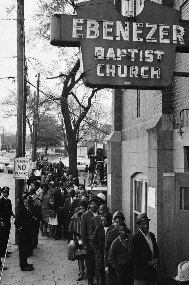 Mourners waiting to view the body of Dr. Martin Luther King Jr. queue up outside the Ebenezer Baptist Church in Atlanta just after dawn in this April 9, 1968 file photo. Photo: RJ, AP / AP