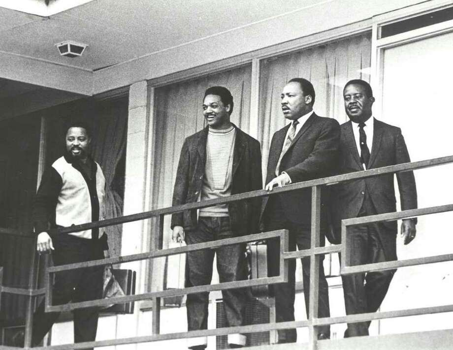 "Martin Luther King Jr., second right, and SCLC aides Hosea Williams, Jesse Jackson Jr., from left, and Ralph Abernathy return to the Lorraine Motel in Memphis to strategize for the second Sanitation Workers march led by King in this April 3, 1968 file photo. King was shot dead on the balcony April 4, 1968. The  photograph is part of the  exhibition ""From Memphis to Atlanta: The Drum Major Returns Home"" at Atlanta's Martin Luther King, Jr. National Historic Site April 4-August 31, 2008. Photo: Express-news, AP / AP"