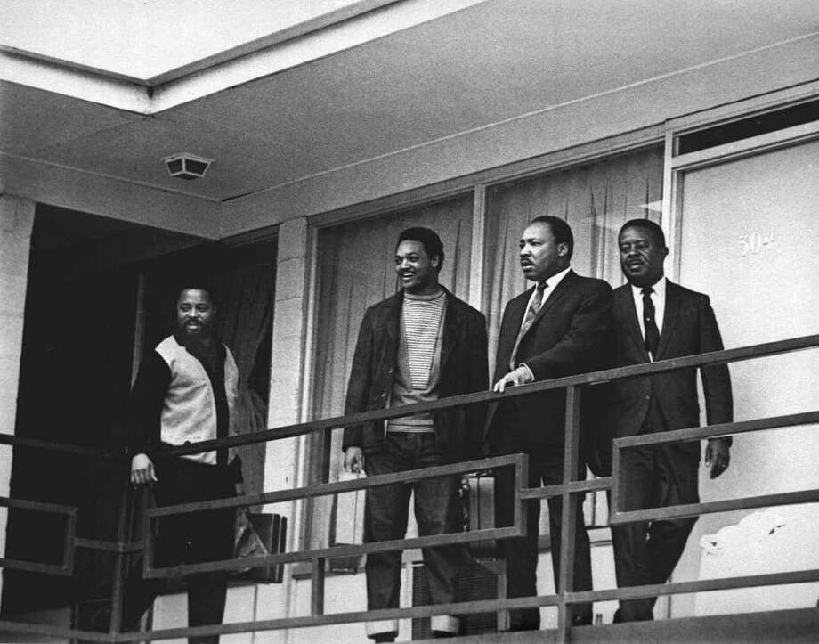 ADVANCE FOR SUNDAY, OCT. 15--FILE--The Rev. Martin Luther King Jr. stands with other civil rights leaders on the balcony of the Lorraine Motel in Memphis, Tenn., April 3, 1968, a day before he was assassinated at approximately the same place. From left, are Hosea Williams, Jesse Jackson, King, and Ralph Abernathy. The 39-year-old Nobel Laureate was the father of non-violence in the 1960s civil rights movement. (AP Photo) Photo: En, AP / AP
