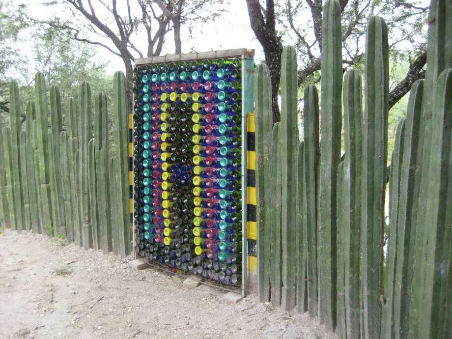 Innovative recycling. The cactus fence is clever and convincing. The glass bottle and mattress spring gate is genius. Kudos go to San Miguel artist Anado McLauchlin. kathy huber / DirectToArchive