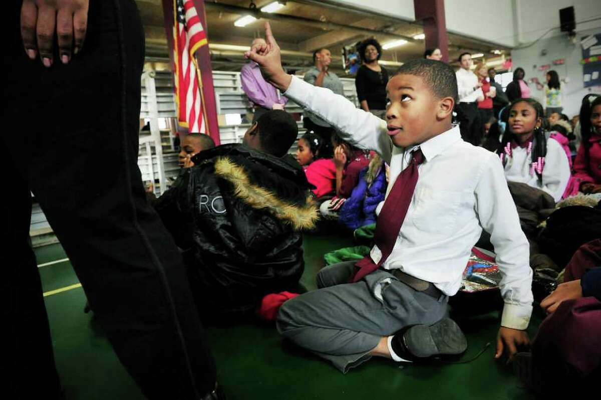 Jarred Griffin, a fifth grader, participates in the daily morning assembly at Jumoke Academy in Hartford, Conn. on Tuesday January 11, 2011.