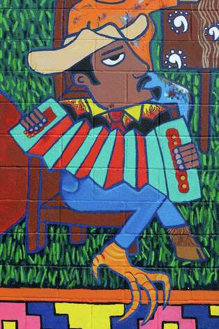 "Detail of San Anto Cultural Arts ""Una Mesa para la Gente"" mural located at the corner of North Zarzamora and West Salinas on Tuesday, Jan. 6, 2009. Photo: JERRY LARA, SAN ANTONIO EXPRESS-NEWS / glara@express-news.net"
