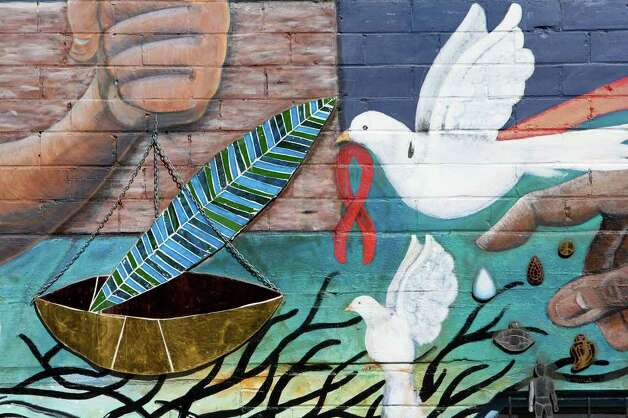 "This is a detail from ""Seeds of Solidarity,"" a mural by San Anto Cultural Arts located at the corner of Guadalupe Ave. and Trinity on Tuesday, Jan. 6, 2009.  Photo: JERRY LARA, SAN ANTONIO EXPRESS-NEWS / glara@express-news.net"