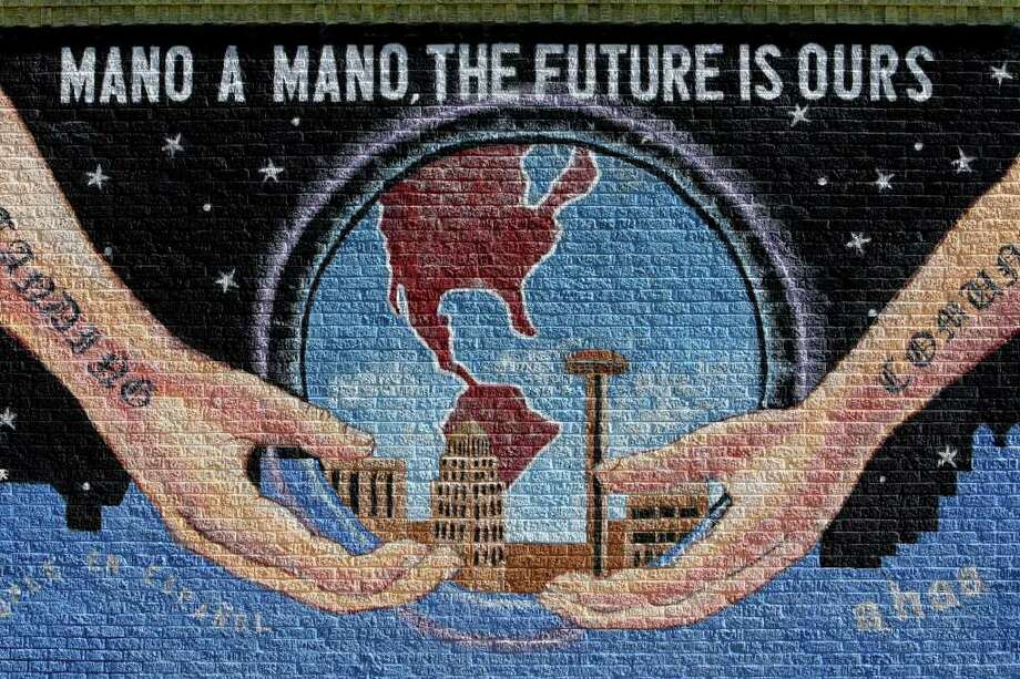"A detail from San Anto Cultural Arts ""Mano a Mano"" mural located at the corner of West Commerce St. and North Pinto St. on Tuesday, Jan. 6, 2009. Photo: JERRY LARA, SAN ANTONIO EXPRESS-NEWS / glara@express-news.net"