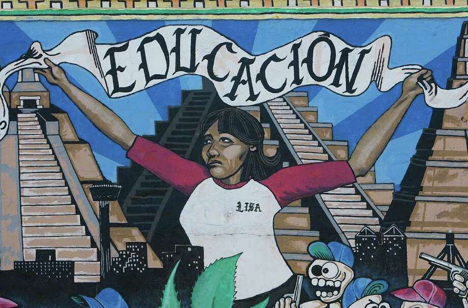 "A detail from San Anto Cultural Arts mural ""Educacion,"" located at the corner of Guadalupe Ave. and Chupadera St. on Tuesday, Jan. 6, 2009. Althougth the mural was restored in August of 1999, it is the first mural by the group and was blessed in July 1994.  Photo: JERRY LARA, SAN ANTONIO EXPRESS-NEWS / glara@express-news.net"