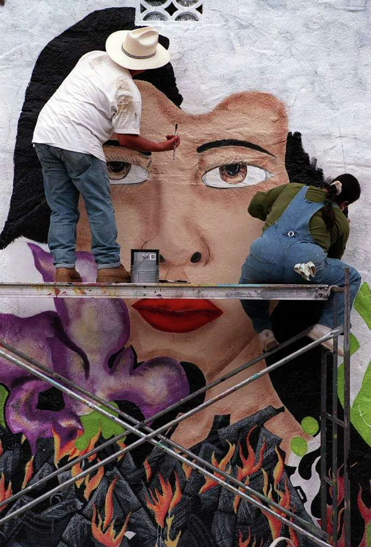 METRO/DAILY: Sonny and Lisa Mendiola (brother & sister) paint a muaral entitled