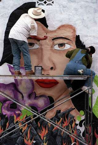 "Sonny and Lisa Mendiola (brother & sister) paint a muaral entitled ""End Barrio Warfare"" near the intersection of Guadalupe and Chupaderas. The mural is sponsored by San Anto Cultural Arts, a nonprofit arts organization. Photo: JOHN DAVENPORT, JD Mural 6"