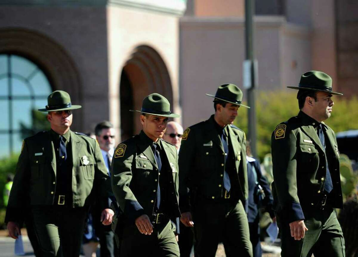 TUCSON, AZ - JANUARY 14: US Customs and Border Protection agents leave St. Elizabeth Ann Seton church after attending the funeral service for US District Court Judge John Roll on January 14, 2011 in Tucson, Arizona. Heavy security surrounds the funeral of Judge Roll, who was shot during the January 8, shooting rampage of Jared Lee Loughner at a political event in Tucson, Arizona (Photo by Kevork Djansezian/Getty Images)
