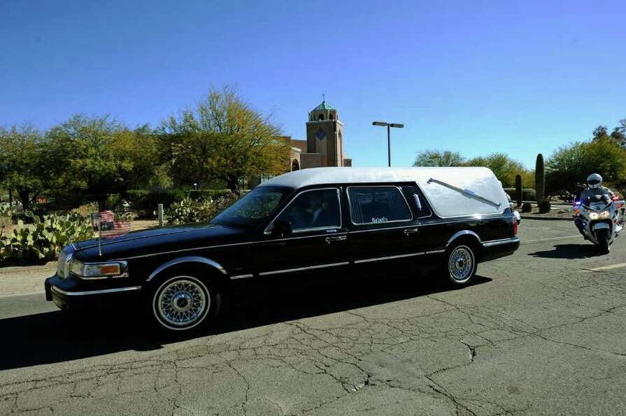 TUCSON, AZ - JANUARY 14:  A hearse carrying the casket of US District Court Judge John Roll leaves S