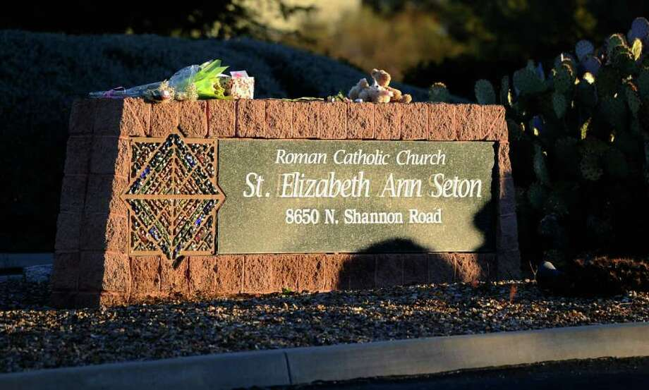 TUCSON, AZ - JANUARY 14:  A teddy bear and flowers are placed in front of St. Elizabeth Ann Seton church where the funeral service for US District Court Judge John Roll is being held January 14, 2011 in Tucson, Arizona.Heavy security surrounds the funeral of Judge Roll, who was shot during the January 8, shooting rampage of Jared Lee Loughner at a political event in Tucson, Arizona  (Photo by Kevork Djansezian/Getty Images) Photo: Kevork Djansezian