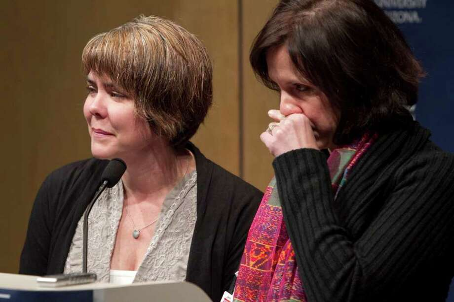 Jenny Douglas, right, and Crissi Blake, daughters of injured gunshot victim Ronald Barber, who was an aide to Rep. Gabrielle Giffords, D-Ariz., announce their father was discharged from the hospital early Friday morning so he could attend the funeral of U.S. District Judge John Roll, during the morning medical briefing at University Medical Center, Friday, Jan. 14, 2011, in Tucson, Ariz. (AP Photo/The Arizona Republic, Carlos Chavez) MARICOPA COUNTY OUT; MAGS OUT; NO SALES Photo: Carlos Chavez